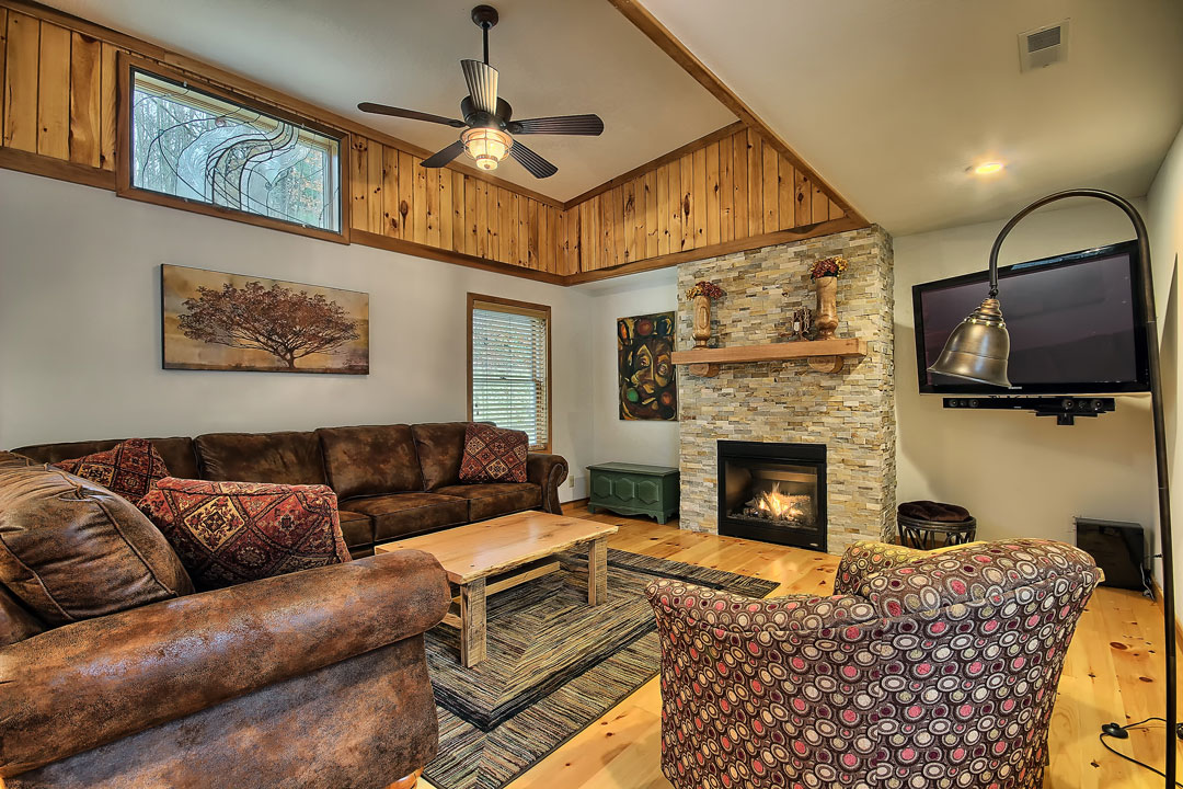 Photo of Two Trees Cabin living room with fireplace