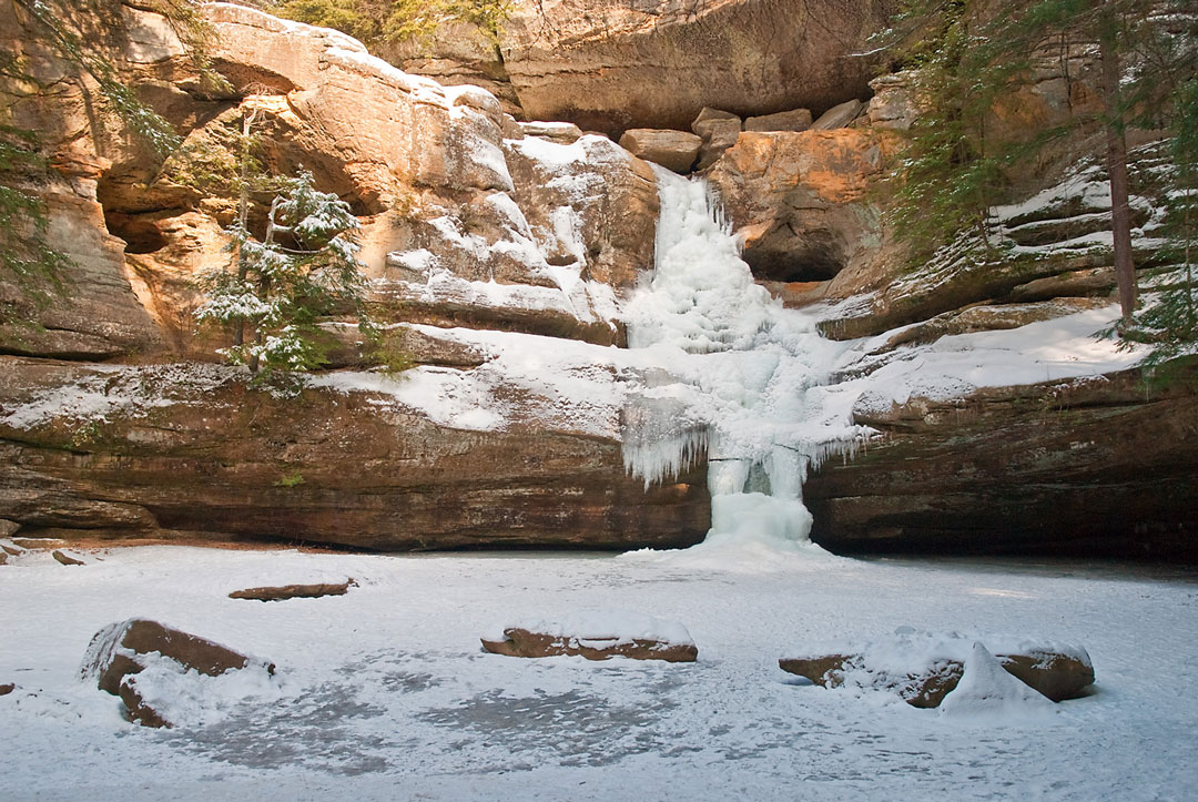 Photo of Cedar Falls frozen over with snow.